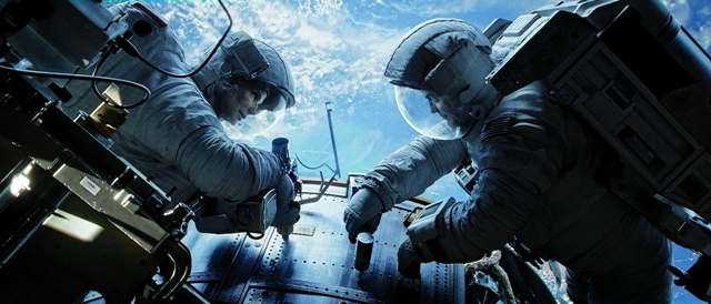 Sandra Bullock and George Clooney enter deep space in Alfonso Cuaron's 'Gravity'. Photo: Warner Bros Pictures